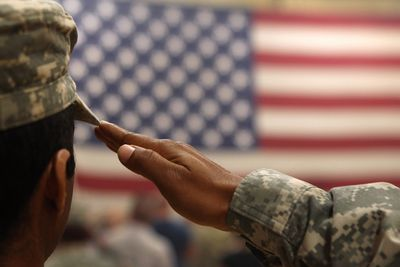 A U.S. soldier salutes the flag