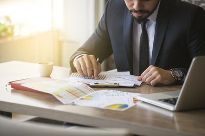 Young businessman studying financial information