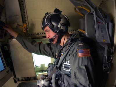 US Navy 030413-N-4441P-001 A U.S. Naval Flight Officer (NFO) adjusts his radar during his pre-flight check off list for a Surface Search Contact (SSC) Tank and Recovery mission aboard USS Nimitz (CVN 68)