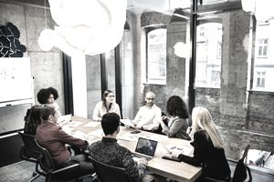 A group of young people in a business meeting