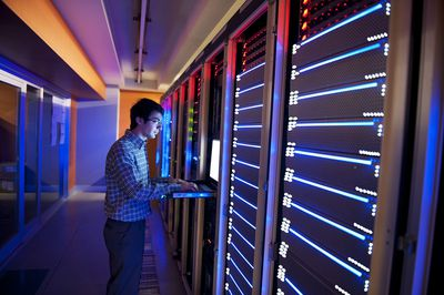 Man Standing in Neon Light With It Servers