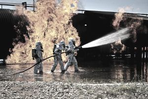 Air Force fire prevention specialists (AFSC 3E7X1) work to extinguish a simulated engine fire at Cannon Air Force Base in New Mexico