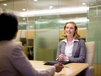 Woman answering leadership questions in a job interview.