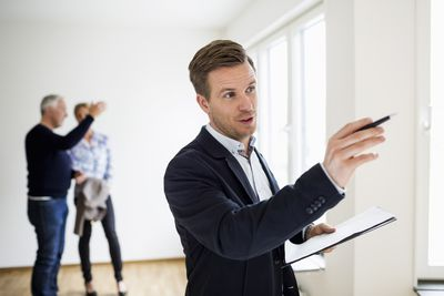 Real estate appraiser examines a home
