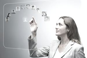 Human resources manager assessing candidates on advanced touch screen interface