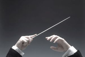 Close up of a music conductor's hands.