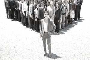 Businesswoman in front of a team