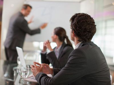 Businessman talking to co-workers in conference room