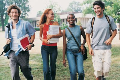 Four Students Walking on Campus