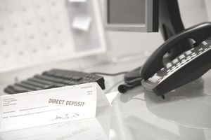 The direct deposit slip is evidence that an employee was paid with a paycheck.