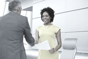 Woman shaking hands with a man at work
