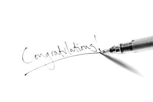 Pen writing Congratulations