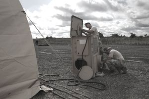Military HVAC/R specialists installing equipment