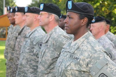 has memberships of the 457th Civil Affairs Battalion standing at attention.
