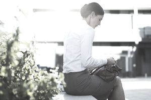 Businesswoman text messaging outdoors