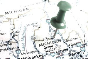 Push pin in a map of Michigan