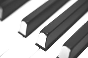 a close up of piano keys