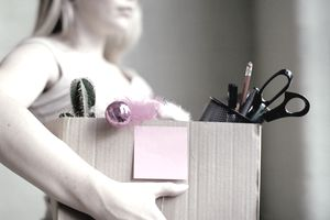 Woman packing up office belongings in box