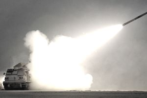 Bravo Battery Multiple Launch Rocket System (MLRS) vehicle fires a M28A1 practice rocket
