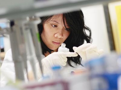 A young woman working in a lab