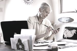 Older woman in office working on document review.