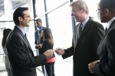 businessmen networking at Chamber of Commerce meeting