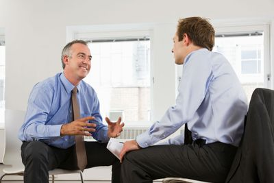 Business coach meeting with younger coaching client