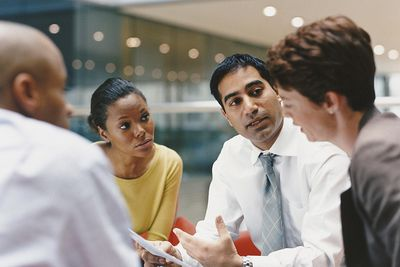 Business people having conversation in corporate environment