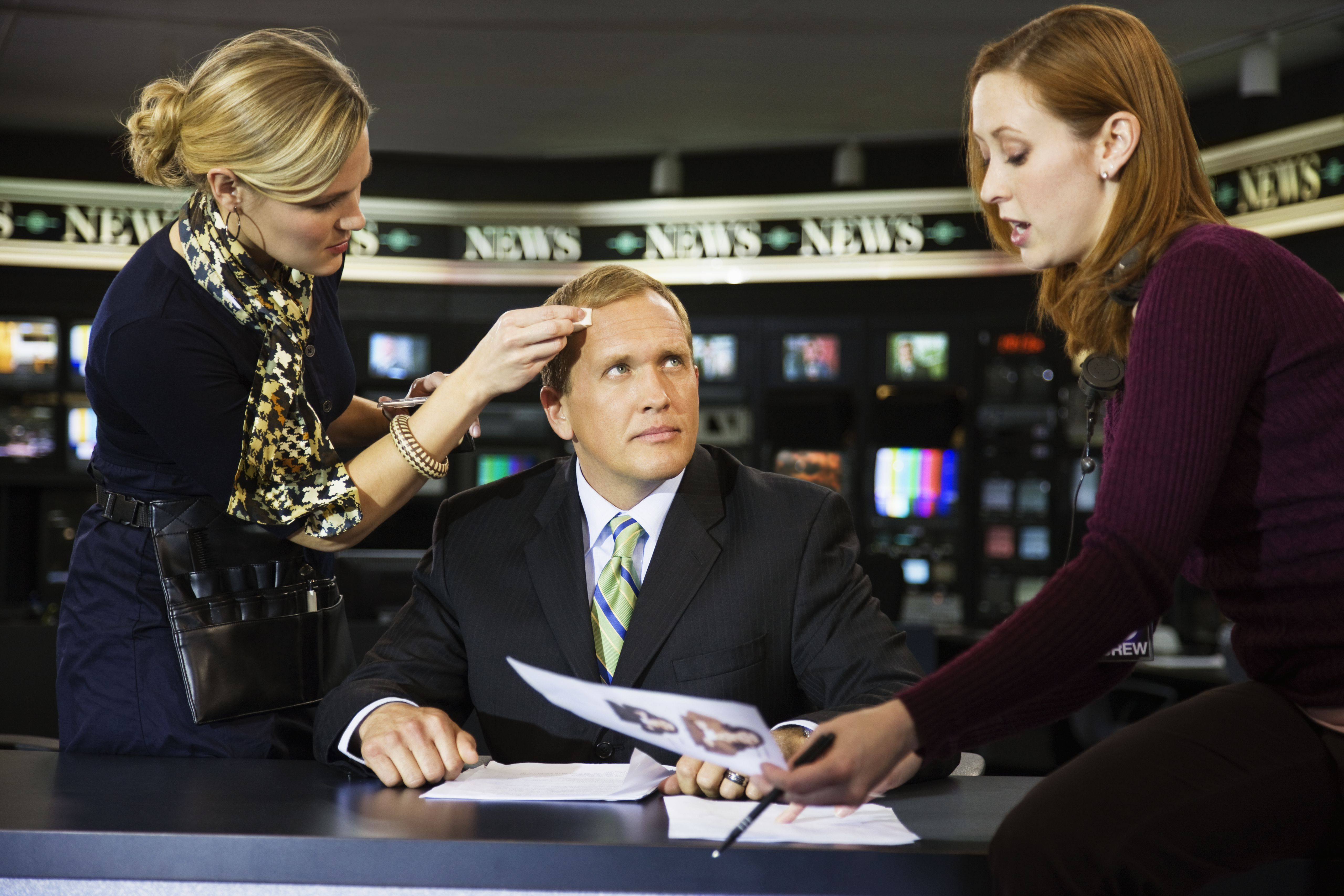 Male newscaster getting ready for interview