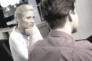 Businesswoman staring at a businessman in an office