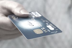 a person holding a debit card