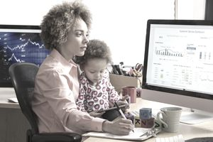 Businesswoman with daughter working at home