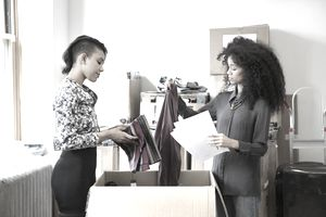Fashion Designers Sorting Through a Shipment