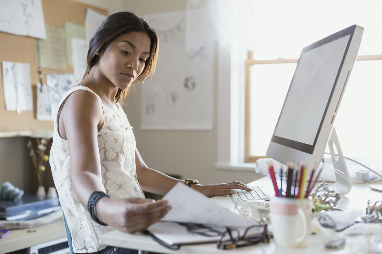Person working at computer in home office