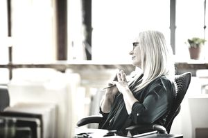 Mature businesswoman listening during meeting