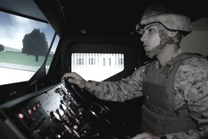 Sgt. Jonathan D. Vanburen trains in a 7-ton truck simulator at the III Marine Expeditionary Force motor vehicle simulator facility April 23 at Camp Hansen. Vanburen is a maintenance management specialist with 2nd Battalion, 4th Marine Regiment.