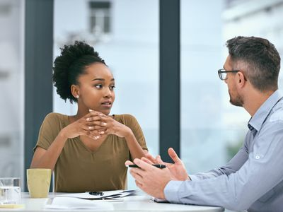 Business woman considering a job offer from a hiring manager.