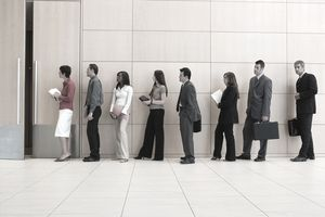 a group of business professionals standing in line