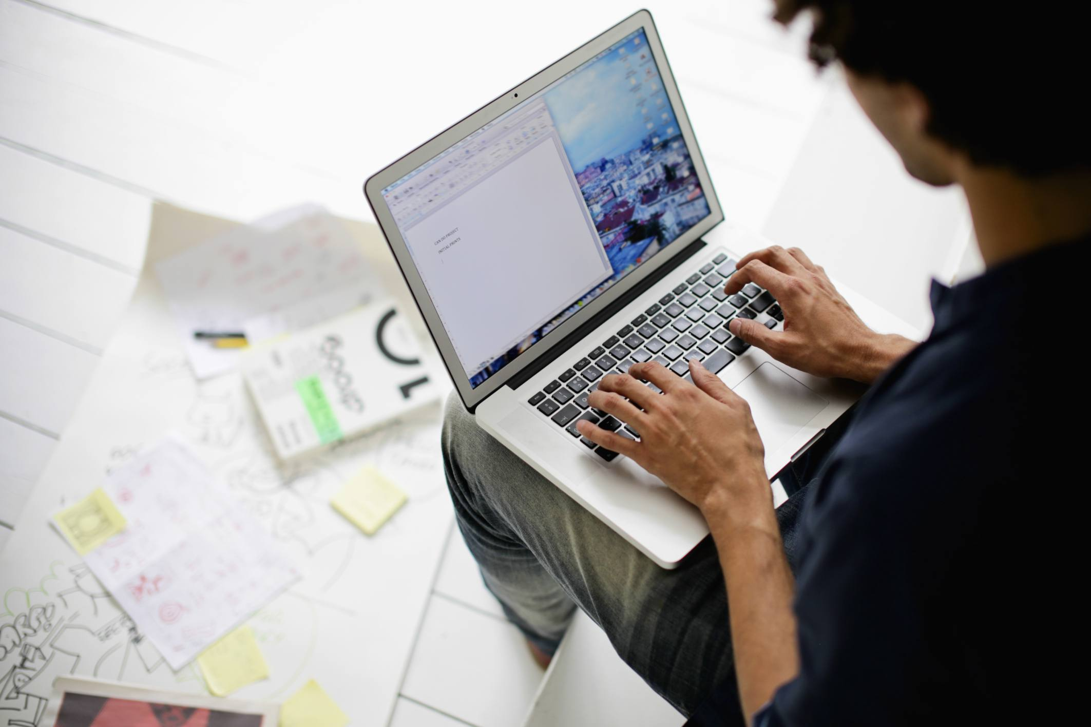 Man using laptop to research a government job opportunity.