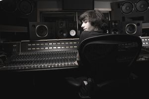 Man in music production / recording studio