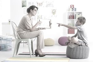 Woman conducting child's psychological test