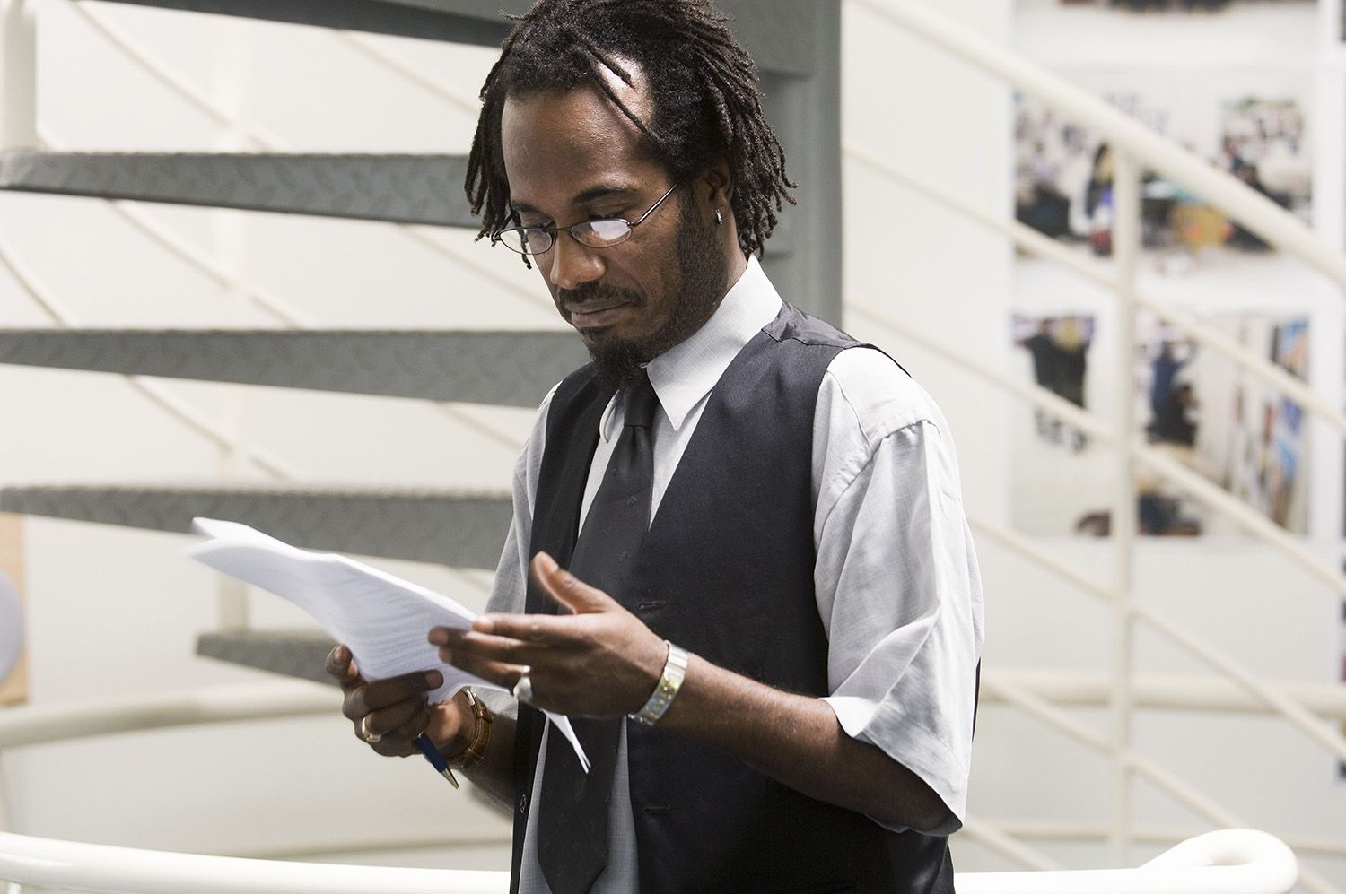 Man Wearing Spectacles, Reading Letter