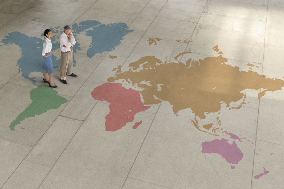 Attorneys standing on world map