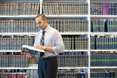 Law School Student reading in law library