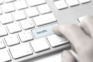 computer keyboard button illustrating employee benefits