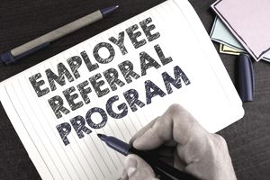 Conceptual hand writing showing Employee Referral Program. Business photo showcasing Recommend right jobseeker share vacant job post written by Man on Notebook Book on wooden background Pen.