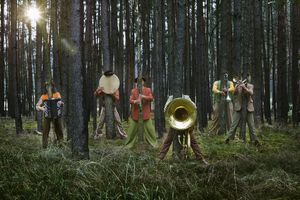 gypsy brass band, hiding behind trees