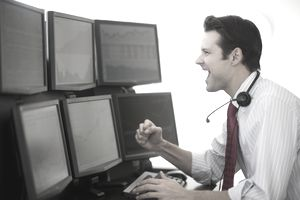 Financial worker analyzing data displayed on computer screen