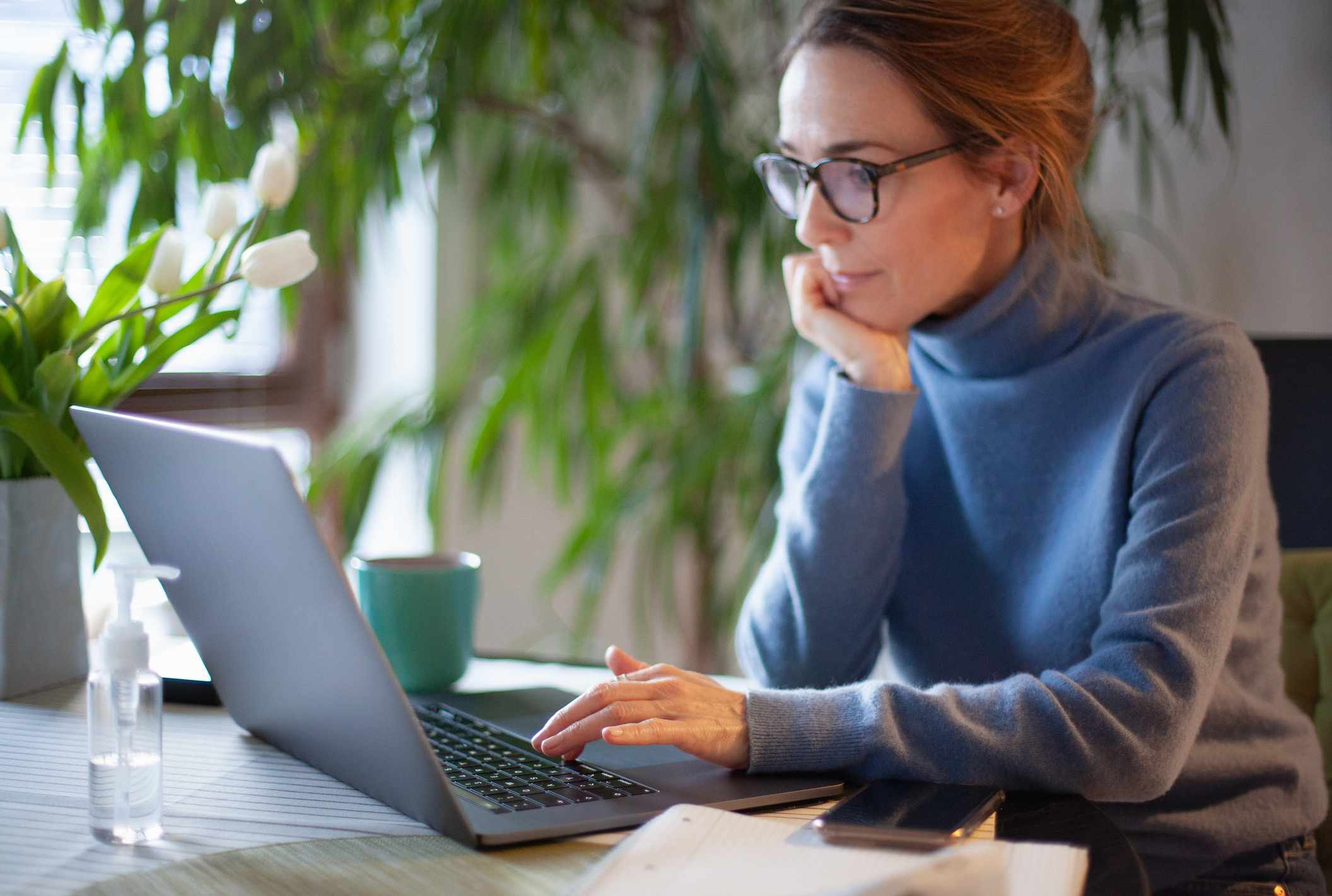 Woman working from home using laptop computer