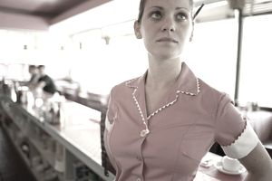 Waitress behind counter in diner